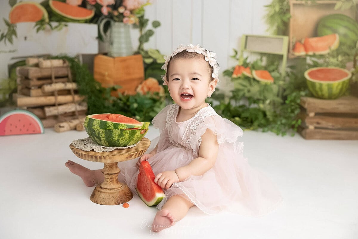 baby photoshoot with watermelon smash theme baby girl laughing